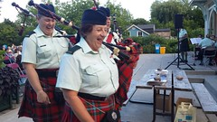 Bagpipers having a little fun (Unionville BIA) Tags: street music irish canada fun live main millennium laugh bandstand markham bagpipers unionville 48th highlanders