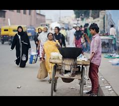 The Popcorn Seller (sownak) Tags: street 50mm bangalore ramadan seller salesman hawker shivajinagar ramzaan