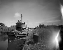 The tug Alan K. Luedke (spiffytumbleweed) Tags: film michigan pinhole tugboat benziecounty fujiacros100 frankfortmichigan betsiebay 4x5film 4x5sheetfilm copyrightedallrightsreserved leonardowideanglepinholecamera thetugalankluedke