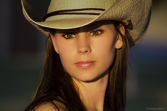 Cowgirl (Kevin Adams.1) Tags: ranch portrait horse beautiful sunshine pose neck model pretty cattle skin bokeh farm country longhair sunny babe attractive western rodeo gloss hottie lipstick cowgirl brunette blush browneyes cowboyhat bullriding goldenhour blushing pinklipstick