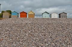 The pebbles on the beach..... (stavioni) Tags: sea beach coast huts pebble jurassic salterton buddleigh