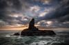 Monolithic (Nick Twyford) Tags: sunset sea newzealand seascape rock clouds nikon wideangle auckland nz northisland westcoast bethellsbeach lateafternoonlight tehenga colourimage leefilters 1024mm d7000 raeakiakipoint lee09nd lee06gndsoft phottixgeoone