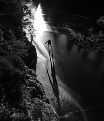 (Svein Nordrum) Tags: winter light shadow blackandwhite bw sun lake motion cold ice nature silhouette contrast dark landscape outdoors frozen movement scenery december skating perspective tourskating stmarka svartoren