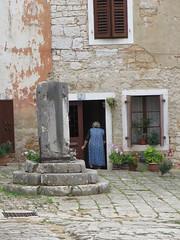 Retreating resident, house at piazza, Sveti Lovreč, Croatia (Paul McClure DC) Tags: people architecture croatia historic istria hrvatska istra svetilovreč sanlorenzodelpasenatico oct2012