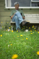 Relaxation 350/365 (*Jilltoo) Tags: flowers newzealand man cup outdoors reading focus seat lawn hut crib getty relaxation sonya7 zeissfe35mmf28za
