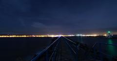 Port la Nouvelle de Nuit (Amanclos) Tags: city longexposure light panorama lighthouse seascape france canon lights aude fr longueexposition portlanouvelle efs1022 canoneos700d potd:country=fr