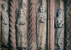 When the Saints go marching in.. (areyarey) Tags: door old city travel italy sculpture detail male art heritage history classic texture abbey face saint st stone wall architecture facade vintage religious carved italian europe italia european catholic pattern exterior cathedral god roman head antique stonework traditional details famous mary religion gothic