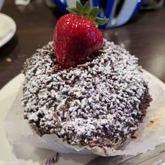 Chocolate cream puff (Coyoty) Tags: townlinediner rockyhill connecticut ct diner restaurant food brown chocolate cream puff creampuff filling sprinkles grenache powdered sugar powderedsugar strawberry fruit red green white dessert sweet square bokeh obligatory ogt
