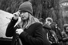 Fine Knit Beanie (Cliff.j) Tags: beanie hat autumn camden candid eye contact street london girl looking adjusting glance look sony a7 carl zeiss sonnar 55mm urban life bridge gesture