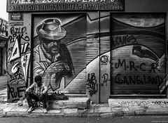 (Georgina ) Tags: blackandwhite monochrome streetphotography people portrait graffiti painting mural art streetart beggar greek athens greece man hat