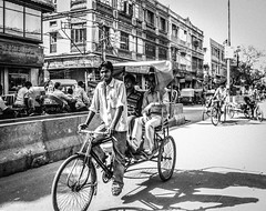 (C-47) Tags: india canon 400d monochrome bw blackwhite rikshaw people street life everyday noir et blanc inde travels looking crossing daylight light
