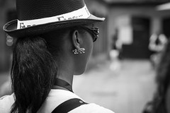 Wild animal tamer... (Periades) Tags: bw blackandwhite blackwhite bijou candid cheveux contrast chapeau fille femme fashion girl glasses human hair hat jewel lunettes mode noiretblanc nb noir photoderue rue streetphotography street streethuman woman
