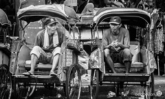 Lunch Break (eddbolton) Tags: city java worldtrip yogyakarta indonesia rickshaw streets taxidrivershavingachat traveling