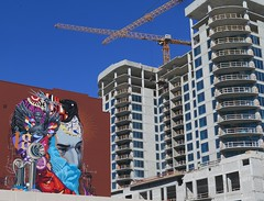 Crossed Cranes (LarryJay99 ) Tags: art blue bluesky buildings city cityscape detail florida layers murals newconstructionsite overhangs patterns railings scape sky stuffonwalls texture urban vista walls wallsbalconies westpalmbeach windows