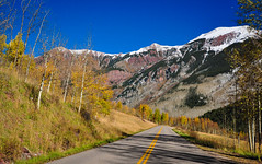Ring the Bells (kirstenscamera) Tags: maroonbells colorado usa nikon foliage aspen fall autumn snow branches trees road drive roadtrip shadows afternoon sky bluesky pine yellowline outside outdoors bare