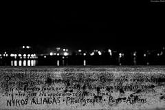 nuit magique Grce 2016 (Georgina ) Tags: monochrome blackandwhite athens greece night sea reflections lights text nikosaliagas