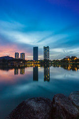 Blue Dusk (bdrc) Tags: asdgraphy landscape cityscape towers lake park reflection water desa citypark sony a6000 tokina 1116 ultrawide athabasca nd filter tripod dusk blue bluehour skyline longexposure bulb sunset