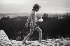 First snow (Dalla*) Tags: boy kid child first snow outside thl valley rnesssla bw monochrome snowball patio winter outdoors swimsuit scandinavian hottub uthlid portrait wwwdallais