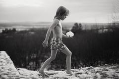 First snow (Dalla*) Tags: boy kid child first snow outside úthlíð valley árnessýsla bw monochrome snowball patio winter outdoors swimsuit scandinavian hottub uthlid portrait wwwdallais