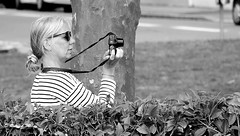 Woman Photographer (patrick_milan) Tags: camera noiretblanc blackandwhite noir blanc monochrome nb bw black white street rue people personne gens streetview fminin femal femme woman women girl fille belle beautiful portrait face candide