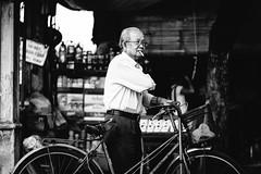 Streets of Hi An (_gate_) Tags: hoi an vietnam 2016 street photography life travel urlaub holiday vacatioin nikon 85mm 18g afs d750 hoian man bicycle fahrrad strase style