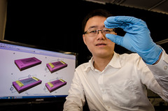 NTU Asst Prof Wang Qijie looking through the mono-layered nanostructured graphene which his team had designed (Lancefury) Tags: camera sensor graphene wangqijie