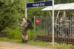 Happy Hedge End Friday (Rusty Marvin - JohnWoracker.com) Tags: sign fence photographer post boots candid shed bikes railway cover hedge hiker friday southampton hedgeend