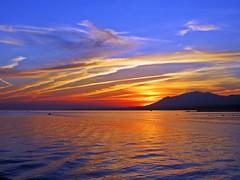 Puesta de sol (Antonio Chacon) Tags: sunset españa paisajes atardecer mar day andalucia costadelsol puestadesol málaga marbella pwpartlycloudy