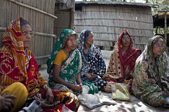A women's group from Rodrodha village gather for a meeting. They all graduated through BRACs Special Targeting Ultra Poor program they are now  known as graduates and are taking part in a project called group home visits.