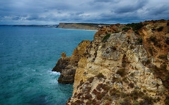 Coastline - Lagos 2 (rschnaible) Tags: ocean sea color portugal water clouds coast sandstone colorful europe day view cloudy cliffs lagos atlantic coastal western vista geology algarve the seacape geologic