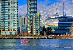 Little Boat, Big City (Clayton Perry Photoworks) Tags: winter ferry skyline vancouver buildings boats falsecreek bcplace