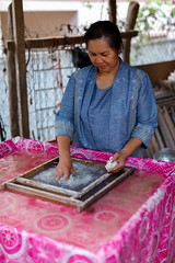 (T.O.OtisPhoto) Tags: travel people men river paper women handmade crafts working arts johnson silk culture photojournalism places tools to tradition laos artisans mekong luangprabang tapley maekong documentray weavingvillage