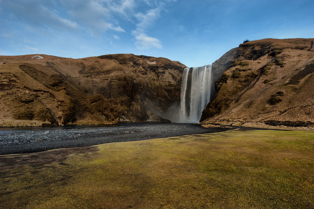 Skogafoss, a waterfall with a 200 ft. drop.