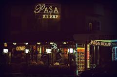 Embracing change (Melissa Maples) Tags: black sign yellow night turkey dark 50mm lights restaurant nikon asia neon text trkiye nikkor afs kemer     50mmf18g f18g d5100 paakebap