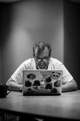 Jim Groom in his element. (bionicteaching) Tags: apple cup coffee work computer groom virginia intense mac focus laptop stickers jim richmond va vcu rva maniac maniacal 5cardflickr lmgtfy