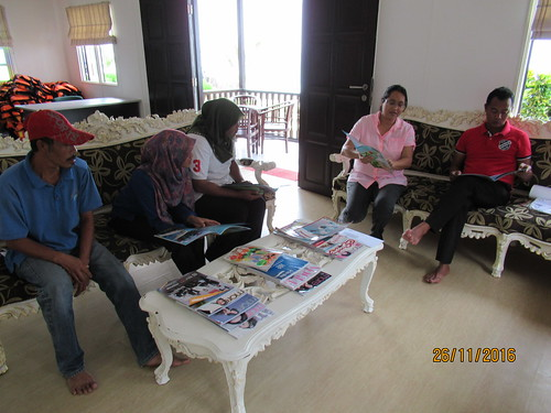 Dr. Leela Teaching storybook to the staff of TAD Marine Resort