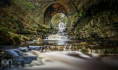 Thortergill Force (ianbrodie1) Tags: cumbria garrigill alston waterfall rocks bridge arch haida 10 stop nd filter nikon d750 longexposure branches water smooth milky