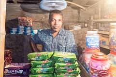 X106_4591 (bandashing) Tags: night nightlife market shop vendor produce street village town sylhet manchester england bangladesh bandashing aoa socialdocumentary akhtarowaisahmed lemon lemonpuffs biscuit fan above head