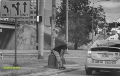 Just so Tired (Halcon122) Tags: homeless corner highway austin texas sign tired man candid streetphotography bw olympusm5markii