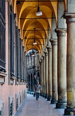 08:57 a.m. (Marie Hlne) Tags: bologna city cityscape street streetphotography italy portici arches architecture man portrait travel canon 50mm colors columns