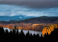 Late Autumn Scenery (bjorbrei) Tags: lake water shore forest trees spruces hills clouds fog countryside farm maridalen maridalsvannet oslo norway