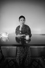 """Madam Yumi"" ( ) Tags: monochrome leicammonochrome leica superangulon 21mm f4 dress tea interior table iso1600"