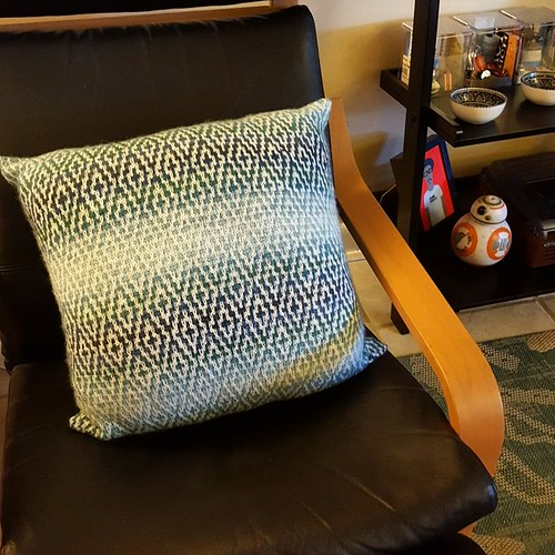 Finished pillow! I knit almost all of this on airplanes.