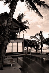 Poolside Bayshore Villas, Candi Dasa. (Triple_B_Photography) Tags: world ocean wood morning travel blue trees sea sky blackandwhite bali plants holiday reflection building tourism nature pool beautiful beauty leaves sunshine clouds contrast altered canon wonderful garden indonesia asian island hotel coast wooden leaf seaside amazing chair backyard perfect gate asia paradise surf afternoon conversion bright zoom edited branches shoreline australian lifestyle sunny sealife location tourist coastal frame tropical destination editing lovely incredible tone tropics adjustment pleasant edit pantai balinese 500d candidasa 2013 elementsorganizer