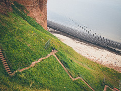 down the cliff... (Kai Krause) Tags: red cliff green film grass stairs pen germany lens island prime coast kodak offshore steps fast mini olympus stairway northsea maritime kai f18 curved portra 800 45mm krause lightroom helgoland preset vsco mzuiko epm1
