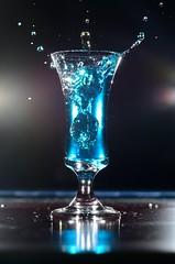 (DigitalCanvas72) Tags: water glass flashphotography freeze splash speedlight foodcoloring nikonsb600 freezemotion nikond7000 nikonsb700 nikkor85mm18g liqourglass