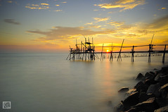 There is still hope (Shahrulnizam KS) Tags: ocean sunset sky sun seascape beach nature water rock landscape photography amazing nikon asia jetty tranquility malaysia slowshutter tranquil johor batupahat nd400 nikond90