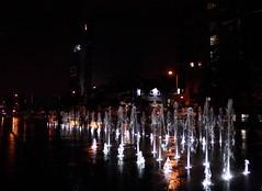 Queen's Square fountain at night (9093b) (avalard) Tags: fountain night shadows victorian belfast northernireland waterfeature urbanlandscape countyantrim streetlighting redevelopment oddmanout urbanarchitecture belfastcitycentre albertmemorialclock