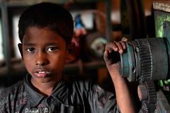 Child Labor III (Iccha26) Tags: boy color male industry asia labor calm bangladesh southasia chittagong bangladeshi