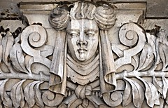 Colosseum 961 (Nathan_Arrington) Tags: thecolosseum columbiauniversity architecture architecturalphotography schwartzgross upperwestside manhattan 116thstreet riversidedrive newyorkcity ny neoclassical head olive branches lowrelief carving sculpture goddess diety allegory doorway face stone morningsideheights